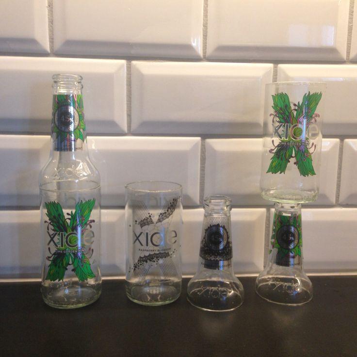 Återbruka glasflaskor X-cider blir värmeljus hållare.