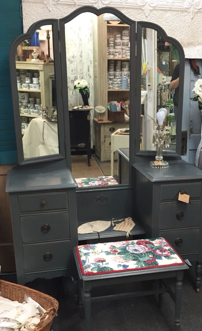 """This is a beautiful antique vanity with large 3 section mirror and bench. It is 46"""" wide. Custom painted by Chick Paint St Joe! From dealer BH at The Rusty Chandelier.  We are packed full of fantastic furniture, vintage finds, home decor and gifts, many one of a kind created or recreated by our talented vendors. An eclectic mix of old and new treasures. Come explore for yourself! Open everyday 9-6!  I-29 and Highway 71, St. Joseph, MO"""
