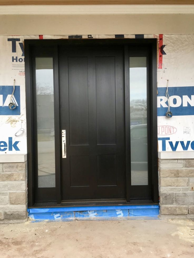 *NEW CONSTRUCTION* features magnificent #handmade #custommade #AmberwoodDoors mahogany #entrance with flat shaker panels; Brown Mahogany stain; acid etched glass in sidelights; sleek #Emtek Lugano lockset in Polished Chrome. Call or come into Amberwood's outstanding showroom today and discover your dream #doors 416-213-8007 #AmberwoodDoors proudly ships #worldwide - Call today for shipping details! 1-800-861-3591 #IHaveThisThingWithDoors #DoorsOfDistinction #DoorsOfTheWorld #CurbAppeal