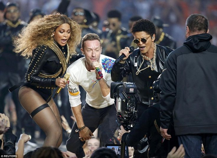 'Believe in love!' Beyonce made an impact in black leather as she brought new song Formation to the Super Bowl in super slick performance with Coldplay and Bruno Mars