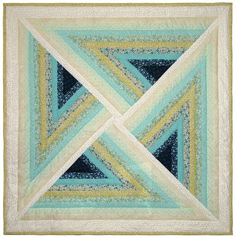 """Coastal Sunrise Illusion quilt, 54 x 54"""", at Quilt Broker. The ten colorful fabrics vary from a deep sea turquoise and blue flower motif to an off-white-on-white floral print."""