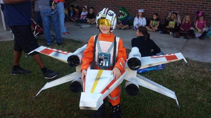 We've reached a consensus: This X-Wing Pilot costume is totes adorbz and the wings are real even if not functional for flying through space.