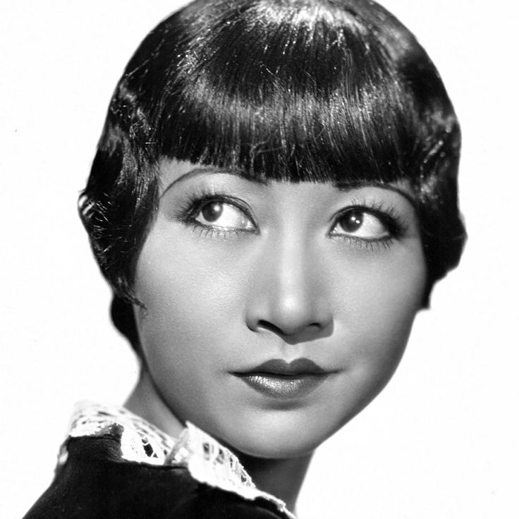 """Anna May Wong, 1905 - 1961 Anna began her acting career while still in school and landed her first role behind her father's back in 1919 as an uncredited extra carrying a lantern in """"The Red Lantern"""". Anna worked steadily for the next two years as an extra until she became ill with St. Vitus' Dance, or Sydenham's Chorea, a neurological illness characterised by uncoordinated jerking movements in the face, hands and feet. Doctors could not help her and unable to pursue her dreams of stardom…"""