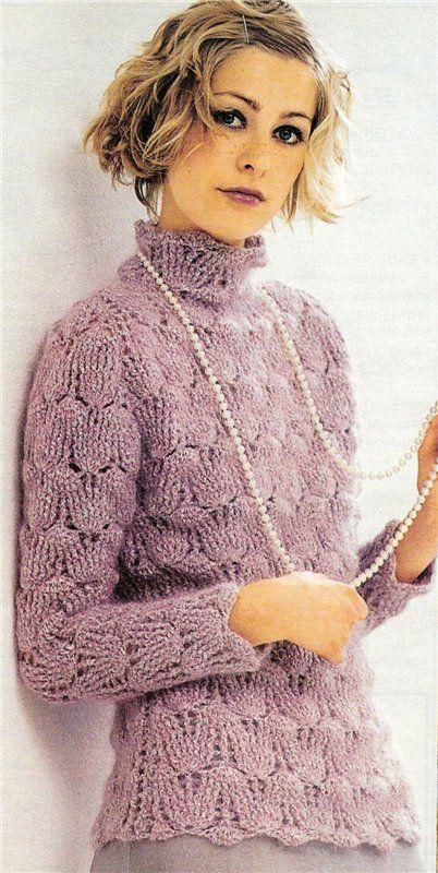 Ecco un meraviglioso maglione invernale all'uncinetto. Il punto utilizzato è abbastanza fitto e il collo alto, combinati evidentemente ad una buona lana le