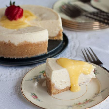 """A rich, creamy Pressure Cooker Meyer lemon cheesecake """"baked"""" in the pressure cooker in just 15 minutes. Top it with a little tart lemon curd to add a little sunshine to your day."""