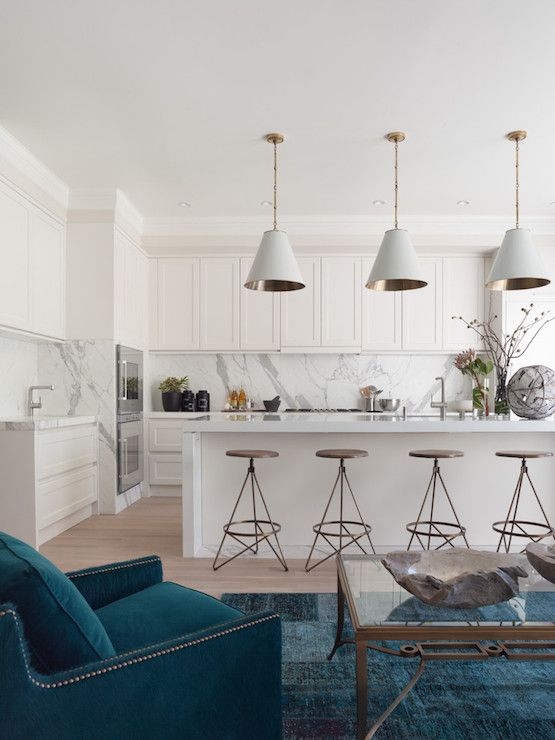 White kitchen, white Goodman pendant, blue rug, Arteriors Barstools.