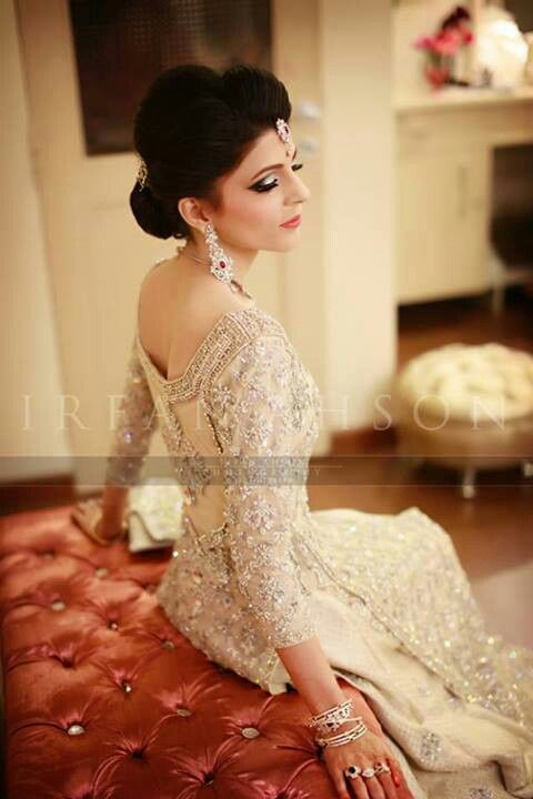 Stunning white, fitted wedding dress with a wide neck, silver embellishment work. It looks traditional yet modern for an Asian Civil Ceremony/ Reception