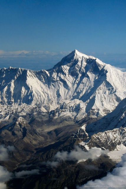 Mount Everest is the Earths highest mountain.t is located in the Mahalangur section of the Himalayas. The international border between China and Nepal runs across the precise summit point. Mount Everest attracts many highly experienced mountaineers as well as capable climbers willing to hire professional guides. While not posing substantial technical climbing challenges on the standard route, Everest presents dangers such as altitude sickness, weather and wind.