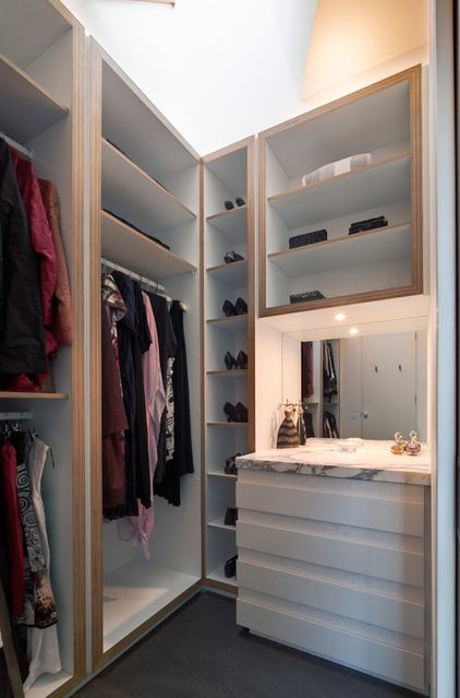 Contemporary Closet by Mihaly SlocombeInstall a mirror or small recess (or both) This may sound a little controversial. Usually, the thinking would go that if you only have a small space for a walk-in you'd need to utilise the whole area, right? I disagree. By dedicating just a small amount to open space the area feels less like a closed-in box. And it's not like it's impractical either. You're left with a lovely little shelf and a mirror for checking your outfit.