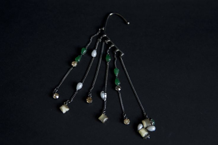 Ear cuff with dangling stones.