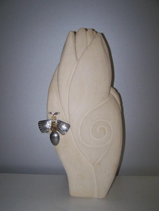 Fertility.      limestone,found objects