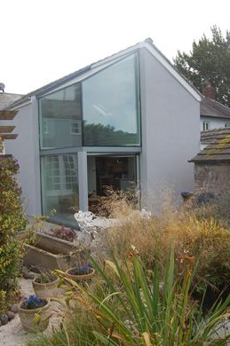 Two storey part glazed extension