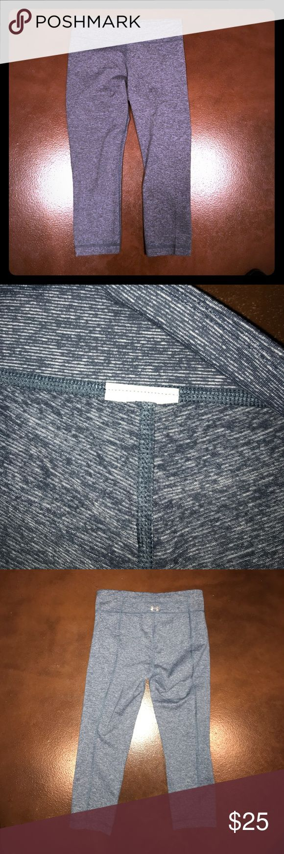 Under Armour Heathered Blue Capri Workout Pants NWOT NEVER WORN Capri workout pants by Under Armour. I did cut the tag out when I tried them on because it felt itchy and I thought I would keep them but I am positive of the size. Other than that, they're in perfect condition with double lining so they won't wear or turn see through and a hidden pocket in the waistband for phone or keys. Under Armour Pants Track Pants & Joggers