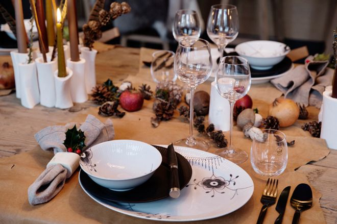 modern Christmas - Chef Tomas Rode and Thilde Maarbjerg's rustic Viking table with hide plate mats, Black Fluted Mega and Black Fluted dishes - Royal Copenhagen via Atticmag