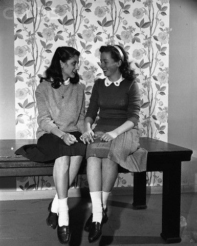 1940s teenagers in Sloppy Sweaters. Pullover styles like those worn on the right were acceptable teen wear too. They were purchased a few sizes up to get the perfect amount of sloppiness.
