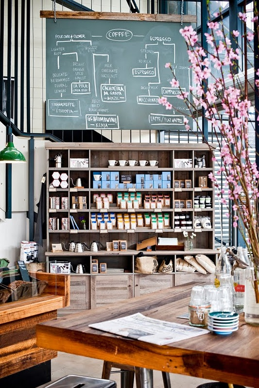 Market Lane Coffee, Melbourne. // Love so many things about this... wooden table, chalkboard, shelf space and the way it's arranged in the open, bright lit up area, flowers...