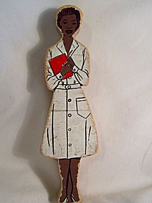 Vintage African American Nurse doll made from wood; ca. 1950s-1960s.