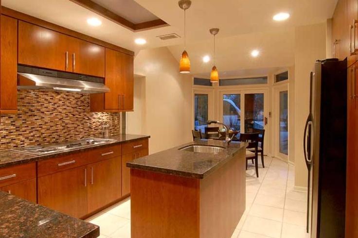 Contemporary kitchen with sleek cherry wood cabinets and unique tile backsplash contemporary - Sleek kitchen world ...