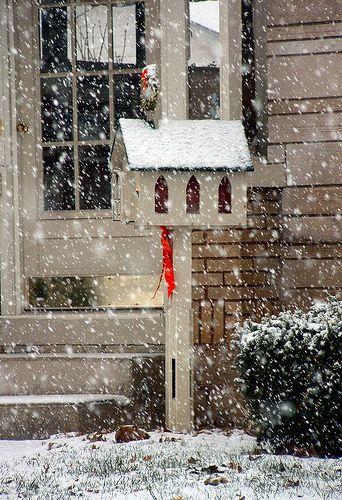 A pretty church-mailbox in the snow.
