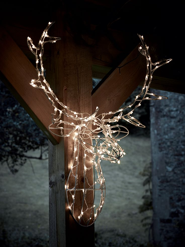 Carefully crafted from a strong metal wire frame, our impressive reindeer head is adorned with approximately 80 ice white LEDs. Suitable for use both indoors and out, this large deer head will light up your porch, hallway or wall and create a whimsical display. Simply plug the transformer into a watertight power source and watch the lights on this deer head shine.