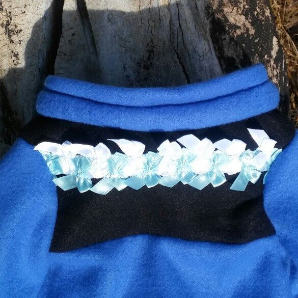 A combination between a royal blue and black tick fleece outlines and contours for bold definition and to top it all off. This outfit is adorned with baby blue and pearl white satin ribbons as a collar and extra finish touch.