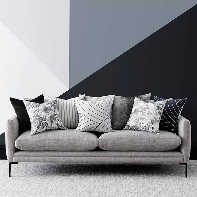 Monochrome magic! Create a bold background with a geometric mural and soften with a mix of patterned fabrics, all available from James Dunlop Textiles. Wall (from left) in Resene Solitude, Resene Half Concrete, Resene Neutral Bay, Resene Charade, skirting board in Resene All Black. Photo Belinda Merrie, styling Celia Faris for @welovefabric #Resene #Reseneblack #Resenecolour