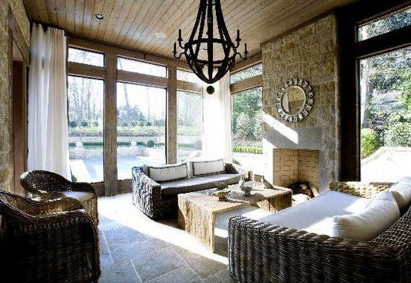 decks/patios - wine barrel chandelier exposed brik walls silver sunburst mirror woven sofas chairs white drapes  Gorgeous Mediterranean sunroom