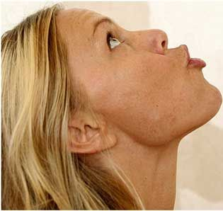 Lift your face upwards and look towards the ceiling as much as you can.     Now blow air out of your mouth. This exercise will firm your jaw lines and will also tone down cheeks making it leaner.
