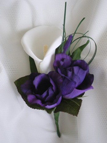 Example of ivory mini calla with purple lisianthis - she would also use the green hypericum berries instead  of the greens shown here.