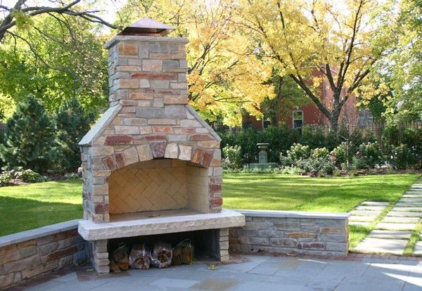 Outdoor fireplace - love it in the corner with a low wall for extra seating!!
