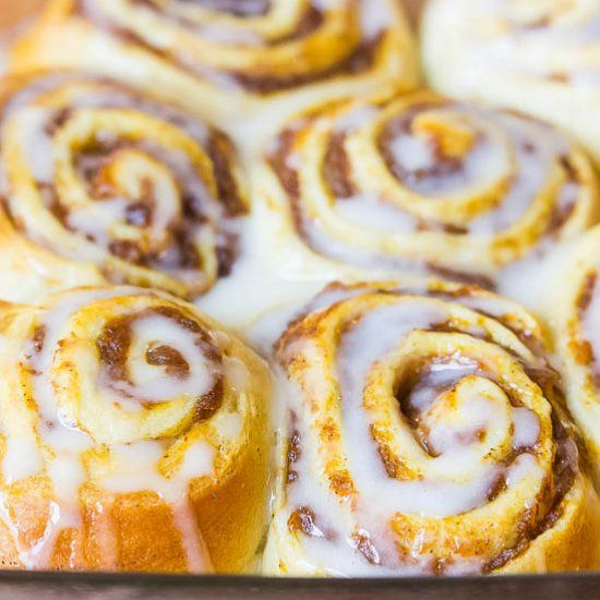 Easy Pumpkin Cinnamon Rolls made with a mixture of pumpkin butter, brown sugar, and cinnamon, topped with a creamy vanilla glaze