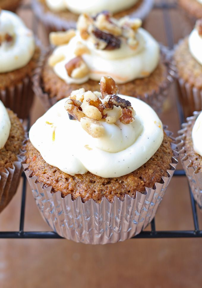 Delicious carrot cake cupcakes, filled and topped with sweet bourbon cream cheese frosting! | honeyandbirch.com