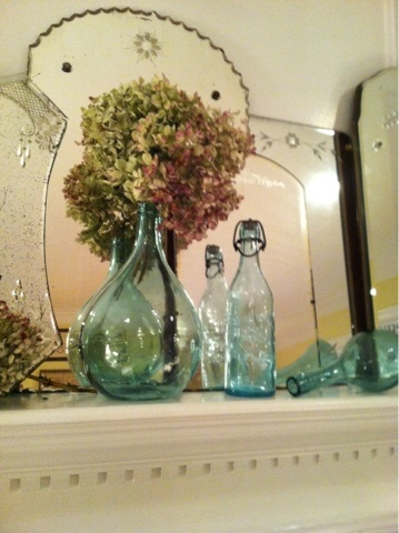 I am a big fan of vintage etched mirrors like these. I never thought of grouping them together. Love it!