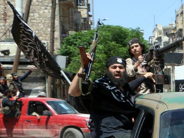 Kerry claims al-Qaeda is a shadow of what it was.  Because you changed the name!  Fighters from Al-Qaeda's Syrian affiliate Al-Nusra Front drive in the northern Syrian city of Aleppo flying Islamist flags as they head to a frontline, on May 26, 2015.