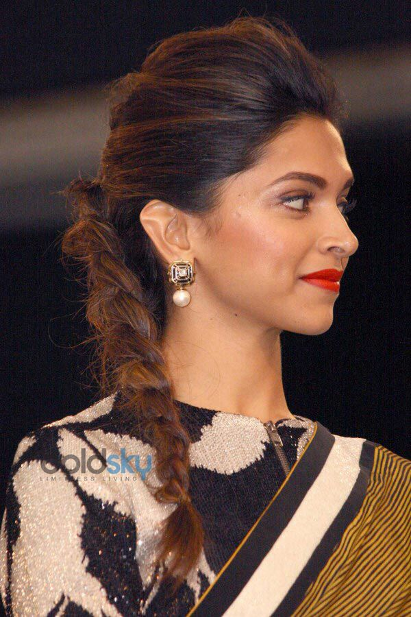 Deepika Padukone Hairstyle. Love this. Volume+side braid+red lip+earrings. And that jacket/sari combo is pretty awesome too