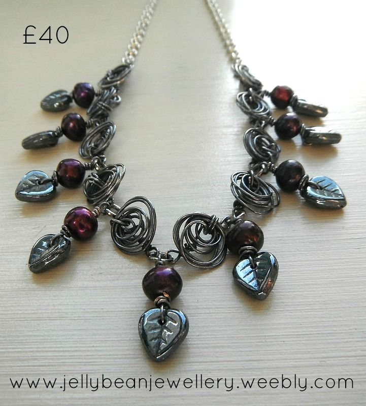 Handmamade wire roses with cultured pearls and czech glass leaves. a beautiful gift to spoil your mum this Mother's Day  http://www.wowthankyou.co.uk/jellybean-jewellery/