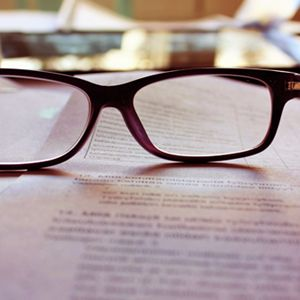 Close up of spectacles on a printed report #coca-cola #structure