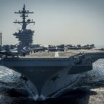 Russian bombers escorted away from US aircraft carrier