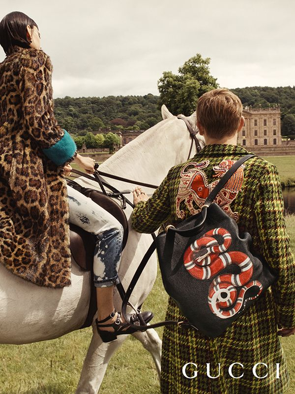 A plush leopard print coat, acid wash jeans, Queercore multi-strap flats, an embroidered tweed coat and the snake print leather backpack from Gucci Cruise 2017.