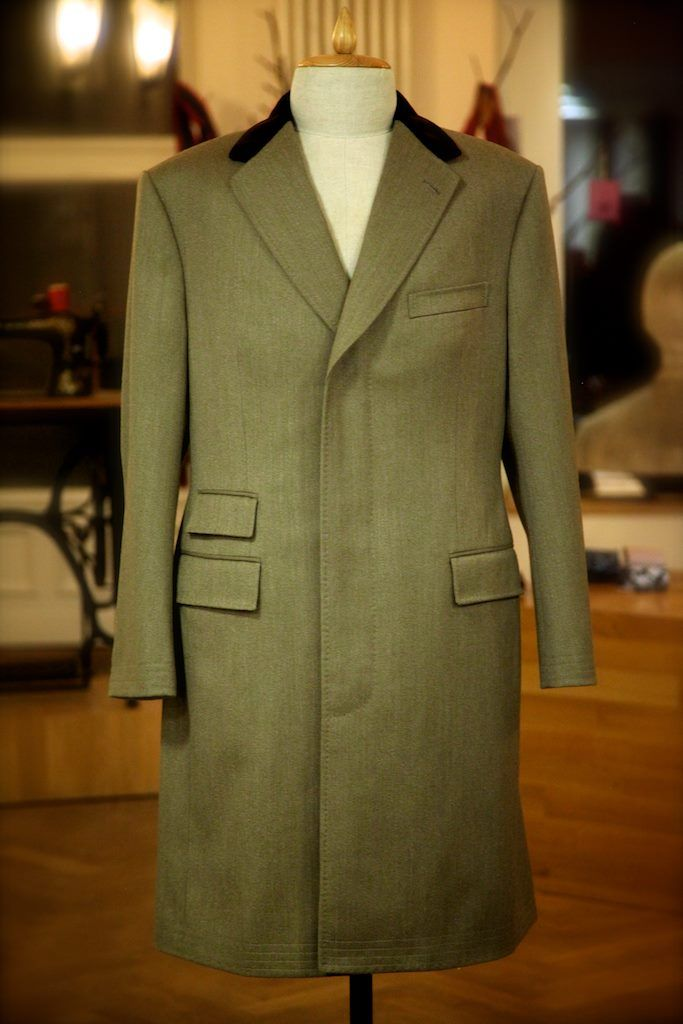 This traditional Covert Coat, made for one of our Viennese clients, features contrasting velvet collar with additional velvet on the inside of the pocket flaps. The fabric is from Fox Brothers of Somerset, and both the hem of the sleeves and the body have the traditional stitching reinforcement to stand up to tough country wear.