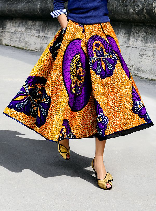 Mustard and purple full midi skirt / blue sweater / blue and white striped shirt / yellow pumps shoes / yellow / paisley