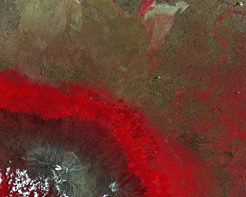 This false-colour image from Japan's ALOS satellite was acquired over part of southern Kenya and the border with Tanzania.