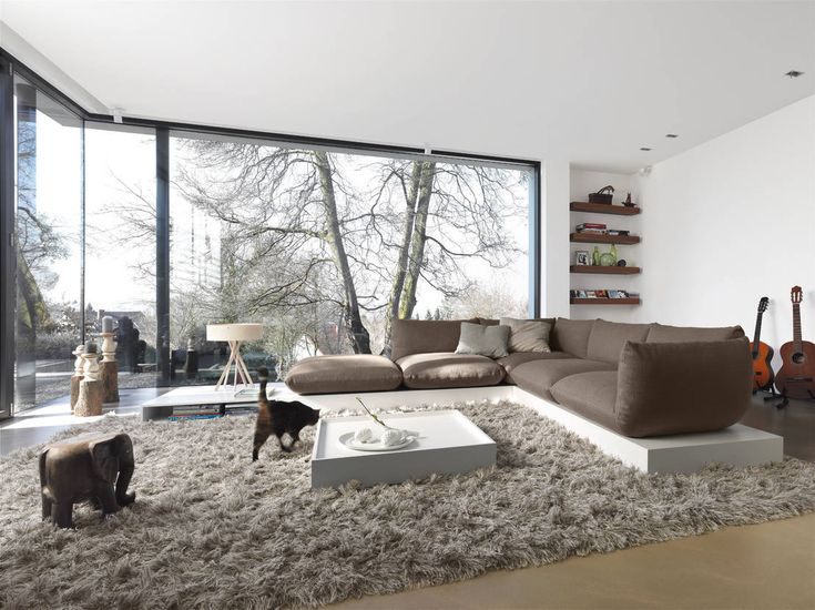 Breathtaking Modern Living Room With Huge, Plush Grey Rug And L Shaped Grey  Couch