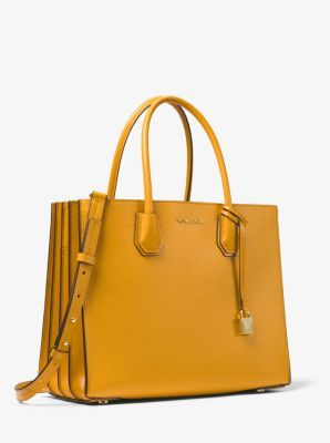 05773e8da0c4 Crafted from pebbled leather, our Mercer tote is updated with accordion  side gussets. Tuck important items—such as your keys, phone and wallet—in  the median ...