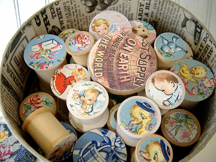 Had fun sprucing up some old wooden thread spools.  I used vintage wrapping paper on most of them.  Just punched out different sized circles & glued them on!