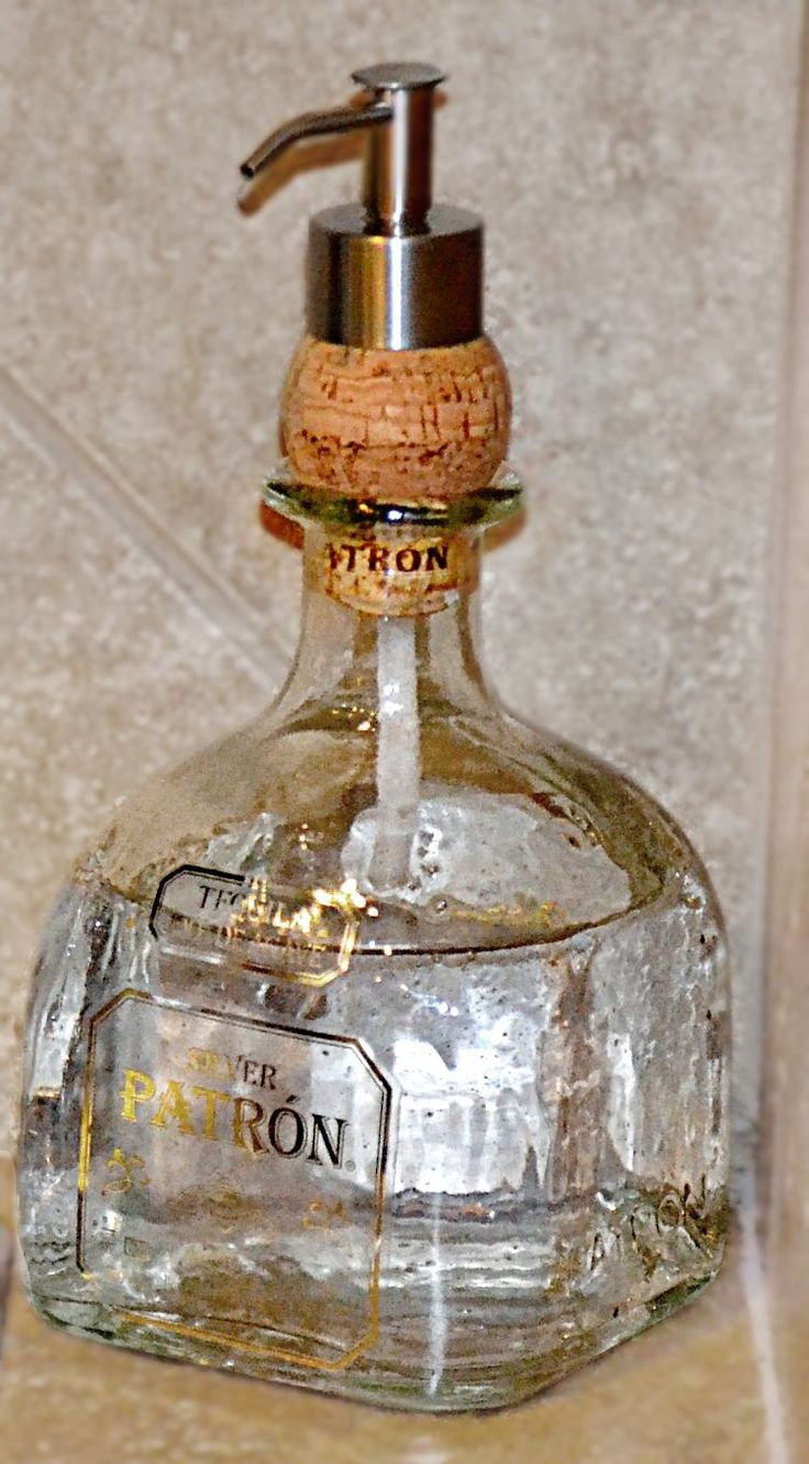 I love the idea of putting the dispenser through a cork - so easy!! Cute for sanitizer in the man cave!