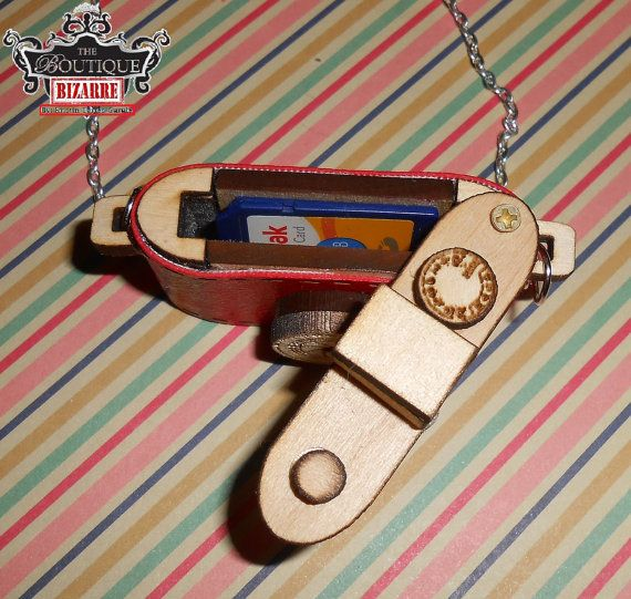 This Laser Cut Wooden Necklace Pendant is handmade in the US, and perfectly cute for any style! This little camera is made from Basswood, cut with a laser cutter, and wrapped with vinyl upholstery to provide the color. The lid is a swivel screw lid. It is about 1.5inches in length