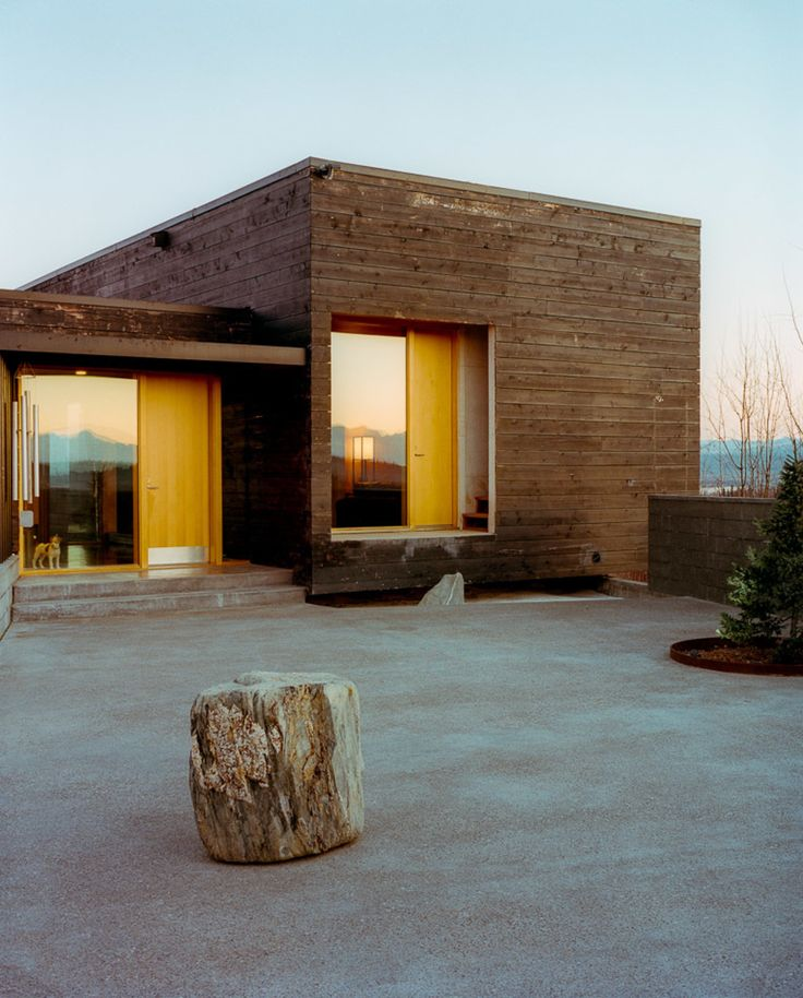 The House for a Musher is all about taking advantage of its hilltop site. The courtyard in the front has vast views and the house itself is oriented toward the surrounding landscape.