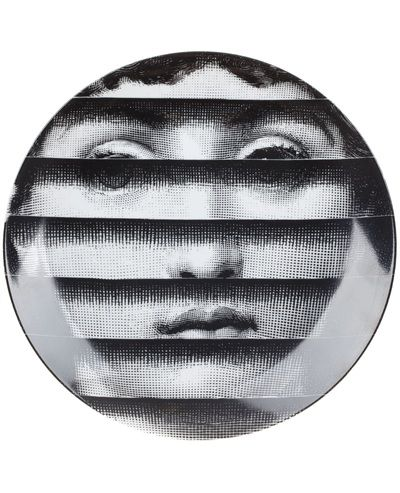 Printed black and white porcelain plate from Fornasetti.