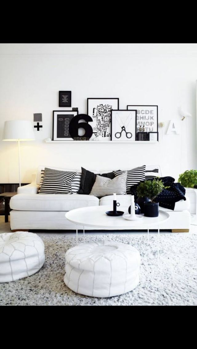 White and black lounge room. Circular coffee table, wall art